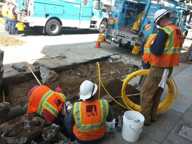PG&E employees replace a stretch of pipeline.
